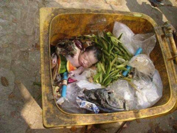 Image result for baby found in garbage